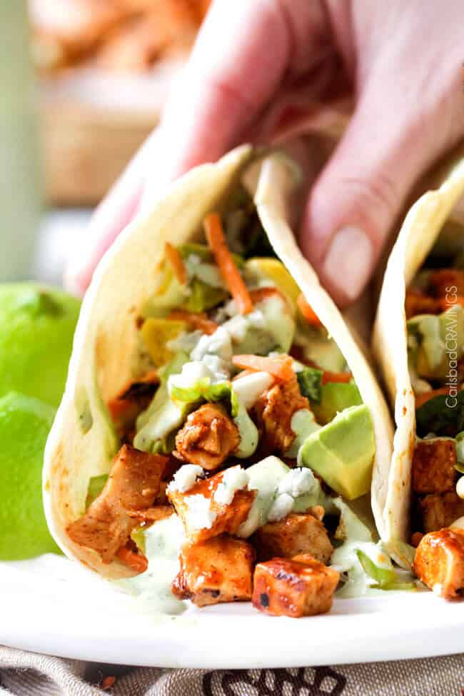Buffalo Chicken Tacos stuffed with the most incredible marinated Buffalo Chicken and drizzled with to-live-for Blue Cheese Cilantro Ranch are ridiculously delicious! Always a crowd pleaser!