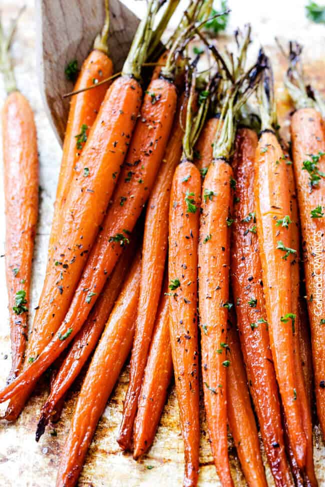 Tender, sweet and savory Secret Ingredient Honey Garlic Roasted Carrots are the most delicious carrots and easiest side dish EVER with only 10 minutes prep! I eat these like candy! #Thanksgiving #Easter #Christmas