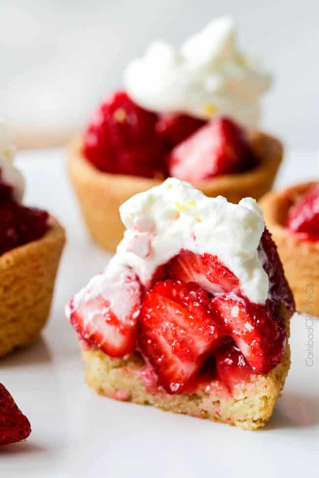 Showing how to make Mini Strawberry Pies with Sugar Cookie Crust by cutting one in half to see the layers.