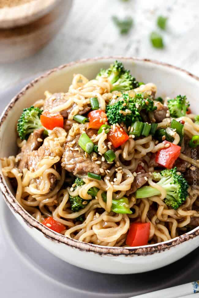 Close up of Beef and Broccoli Noodle Bowls with sesame seeds.