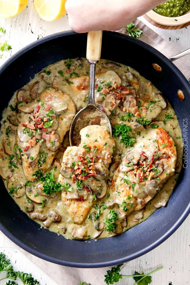 LIGHTER 30 Minute Chicken in Creamy Mushroom Sauce with Bacon and Pesto is one of the easiest yet most delicious chicken dinners you will ever make! Love it alone or with pasta, rice or potatoes, etc..