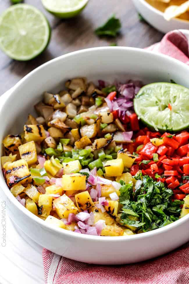 Sweet and smoky Grilled Pineapple Pear Salsa - the combination of grilled pineapple, pears, red bell peppers, red onions AND jalapeno is out of this world! Amazing alone or with chips, fish, chicken etc.