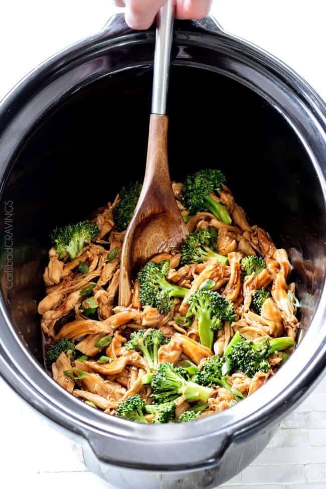 mongolian chicken and broccoli in slow cooker insert with spoon
