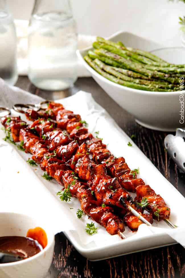 BBQ Chicken Kebabs on skewers on a white plate.