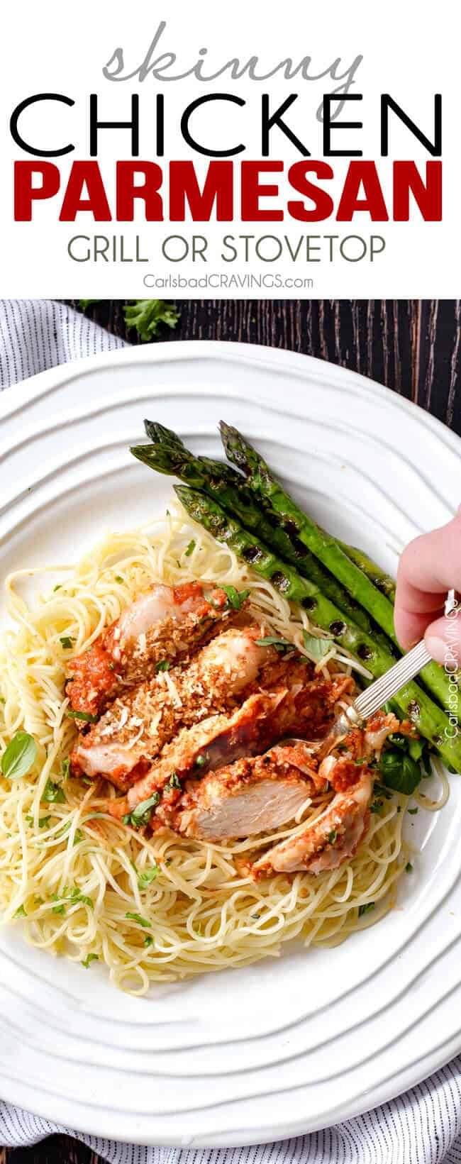 Skinny Chicken Parmesan on a white plate with asparagus.