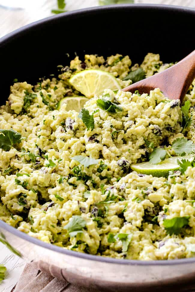 Close up view of Creamy Cilantro Lime Avocado Rice with lime.