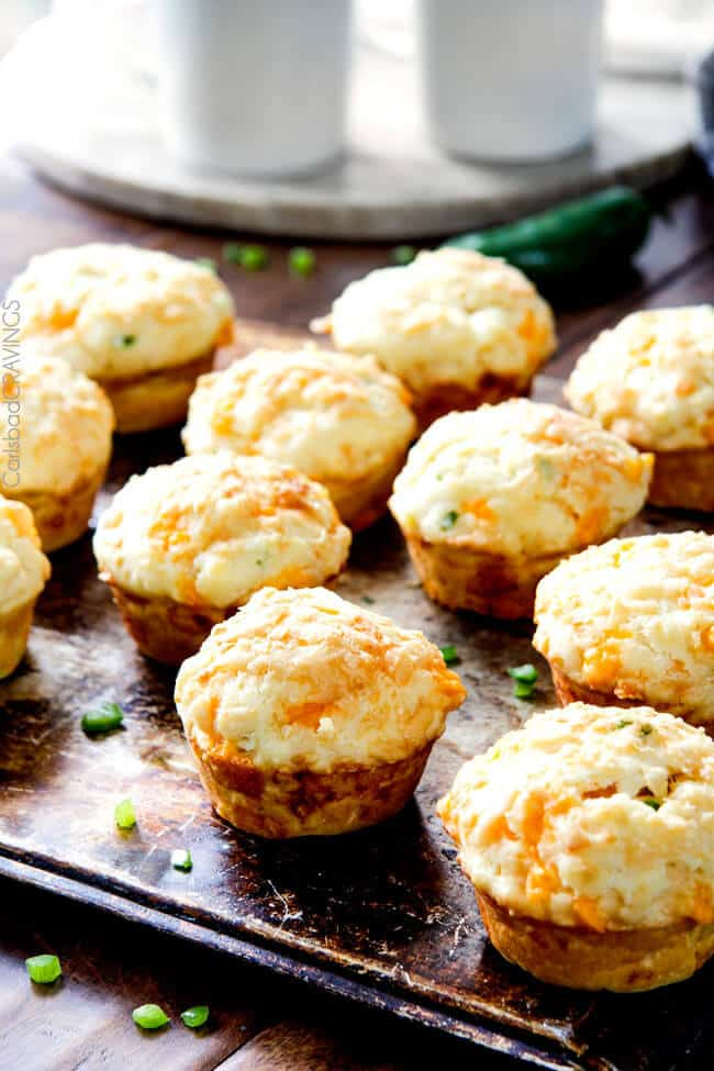 Several baked Jalapeno Popper Cheese Muffins.
