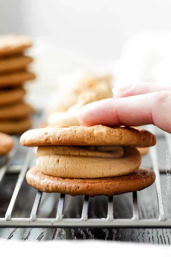 stacking easy Peanut Butter Cookies on a cooling rack