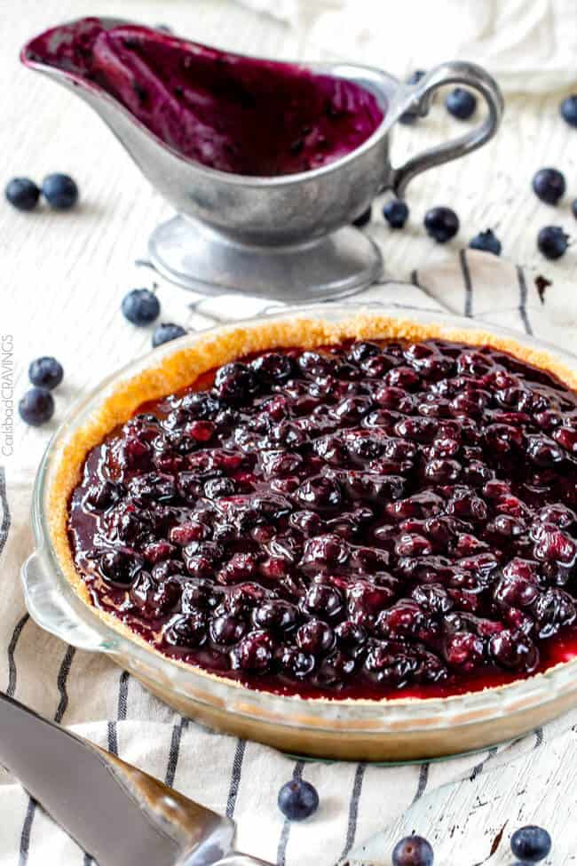 Blueberry Cheesecake Pie with fresh blueberry sauce