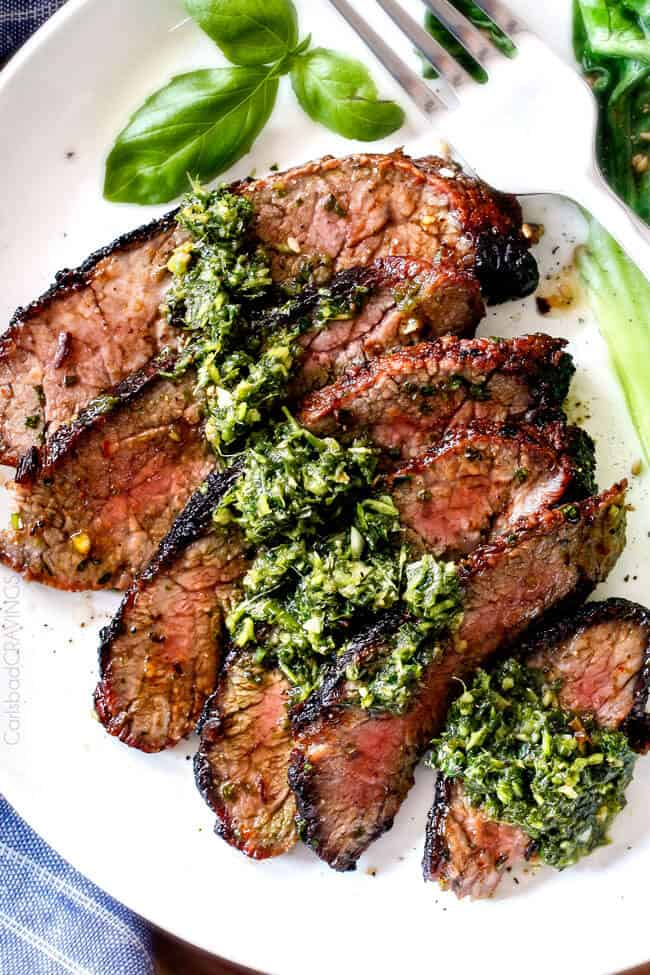 Top photo of of Grilled Asian Steak with Chimichurri sauce on top.