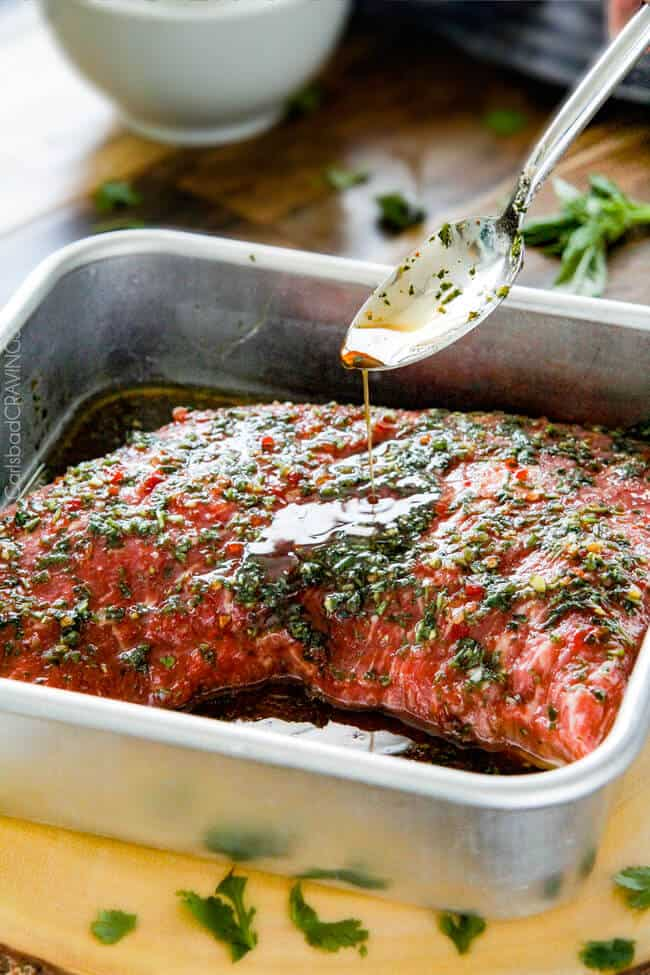 Showing how to make Grilled Asian Steak by marinading the steak adding Chimichurri sauce.