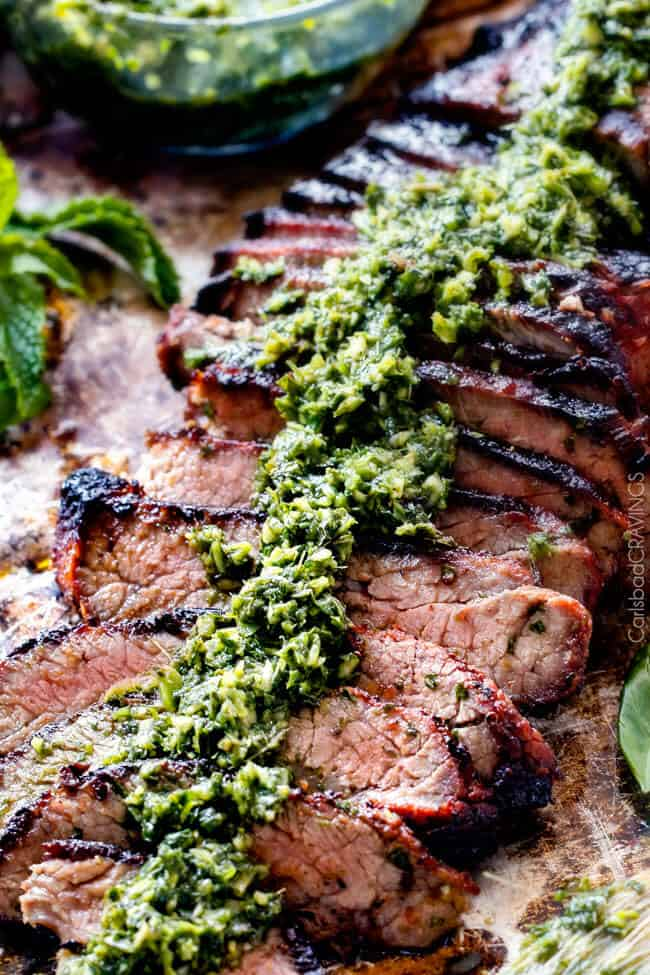Close up of Grilled Asian Steak with Chimichurri sauce on top.