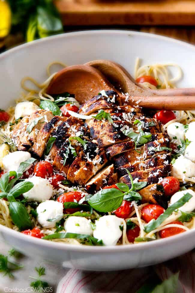 Caprese Chicken Pasta in a bowl with grilled chicken.