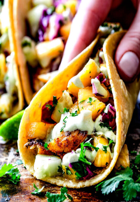 Mind blowing Blackened Fish Tacos with a quick marinade and the most flavorful spice rub! These are hands down the BEST FISH TACOS ever! And the sweet and tangy Pineapple Cucumber Slaw and Avocado Crema hit this one out of the park! seriously better than my favorite restaurant!