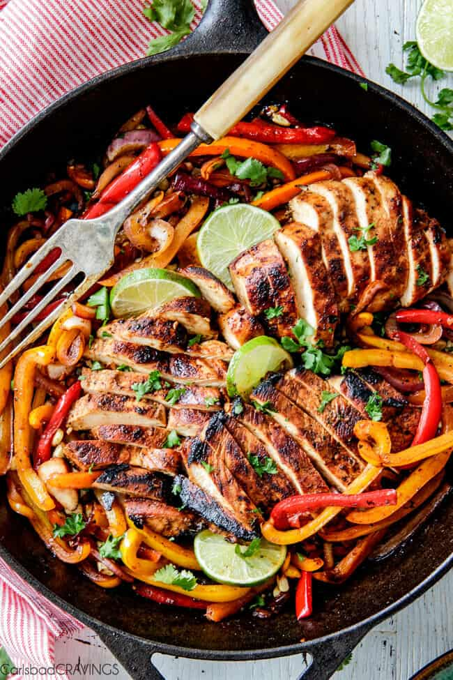 easy Skillet Chicken Fajitas - these are the BEST chicken fajitas! the marinade is seriously the best I've ever tried - better than any restaurant! My family LOVES these this filling so much we also use it for filling in burritos, enchiladas and salads!