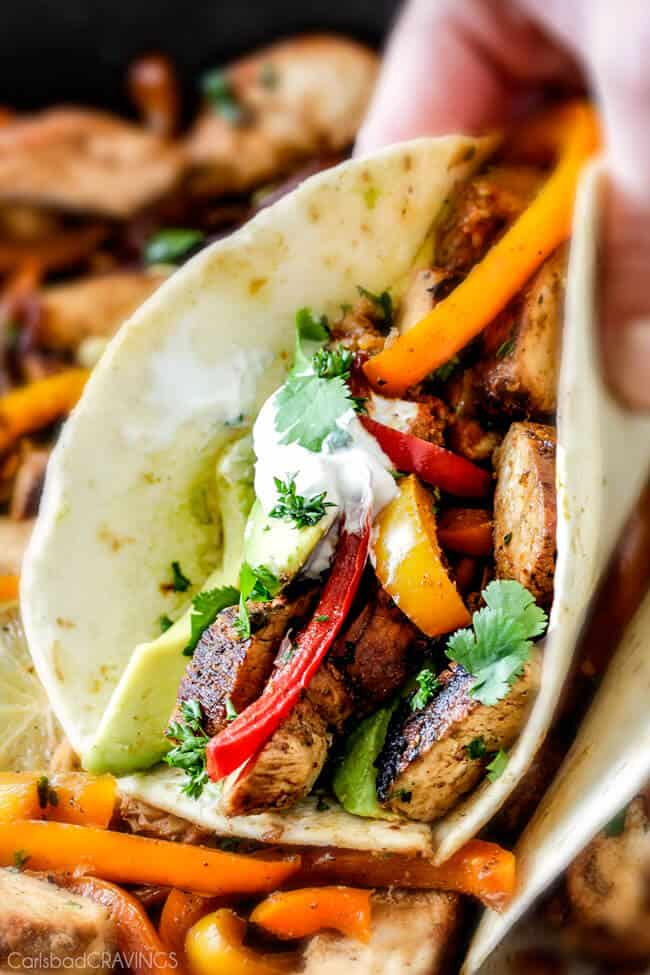 easy Skillet Chicken Fajitas - these are the BEST chicken fajitas! the marinade is seriously the best I've ever tried - better than any restaurant and only 10 minute cook time! My family LOVES this filling so much we use it in quesadillas, burritos, and salads!