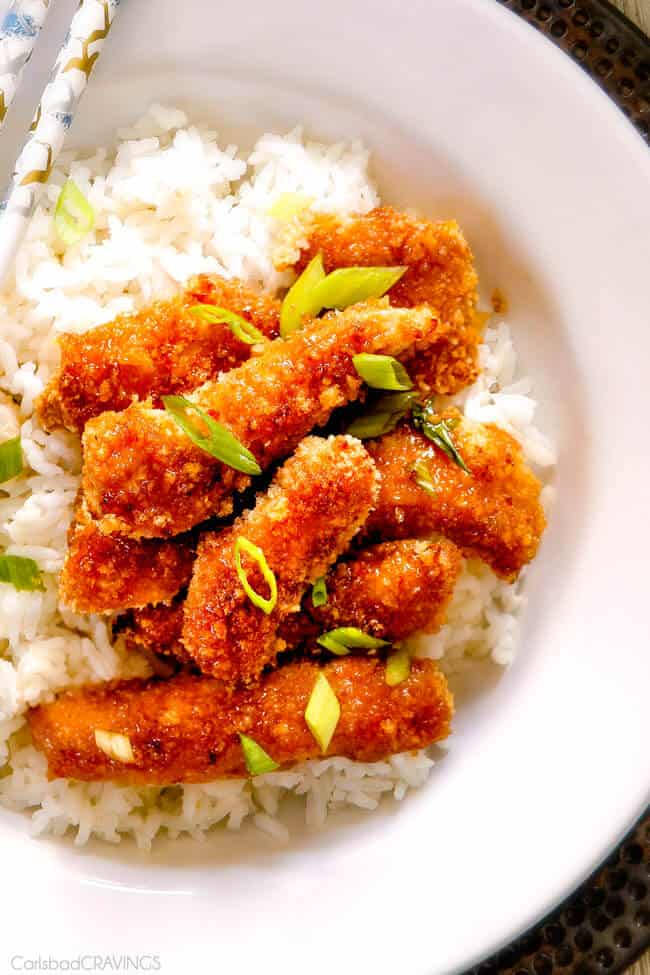 Top view of Crispy Chinese Lemon Chicken with green onion on top.