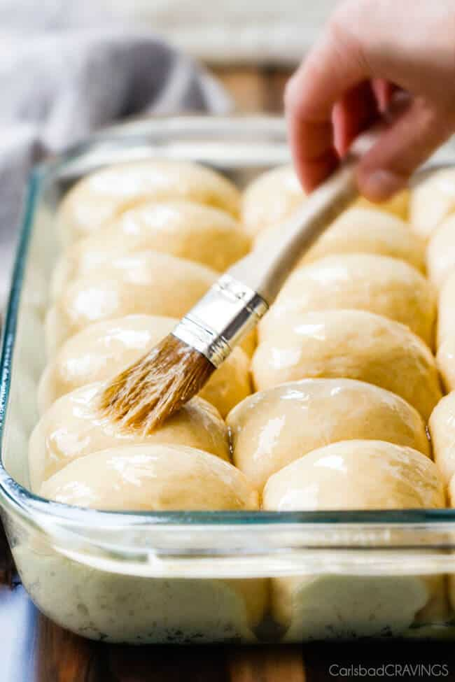 sweet, buttery, Hawaiian Sweet Rolls are super soft and fluffy infused with pineapple juice and slathered in butter! My family LOVES these! perfect for sliders, potlucks and special occasions like Thanksgiving!