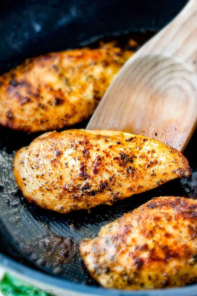 Showing how to make Maple Dijon Chicken Skillet by cooking the chicken in a frying pan.