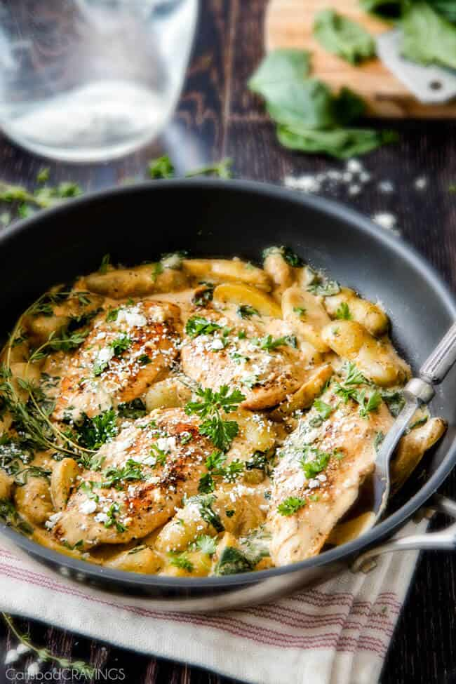 Maple Dijon Chicken Skillet with Fingerling Potatoes and Spinach in a pan.