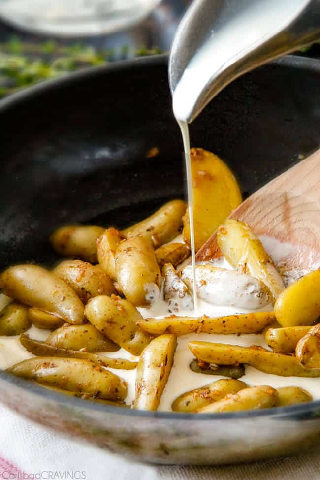 Showing how to make Maple Dijon Chicken Skillet by preparing the Fingerling Potatoes in a pan.
