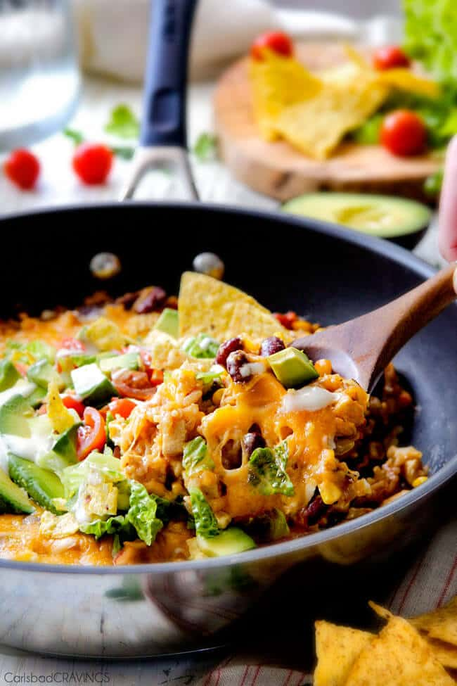 Creamy, Cheesy One Skillet Mexican Chicken and Rice on your table in 30 minutes! My family BEGS me to make this constantly and I LOVE it too! Quick, easy and packed with flavor and texture! We also love it as the base for taco salad. You definitely have to try this one!