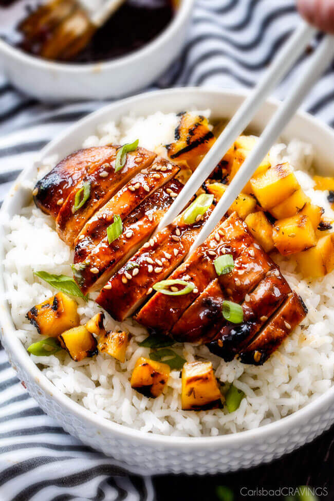 5 Minute prep Easy Teriyaki Chicken infused with Sweet Chili Sauce for added depth of flavor and YUM! The marinade doubles as the sauce for an easy family favorite that tastes better than takeout! My family loves this with rice and stir fried veggies and I love it on salad or in wraps!