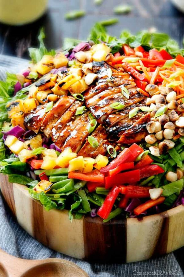 Teriyaki Chicken Salad - This salad is to live for! Packed with refreshing pineapple, macadamia nuts and coconut all doused with the most AMAZING Pineapple Sesame Dressing and the Sweet Chili Teriyaki Chicken is incredible! But my favorite part is you drizzle the leftover Teriyaki glaze all over the salad! Definitely a keeper!