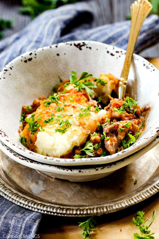 a bowl of the ultimate Shepherd's Pie made with short ribs or ground beef, carrots, celery, mashed potatoes