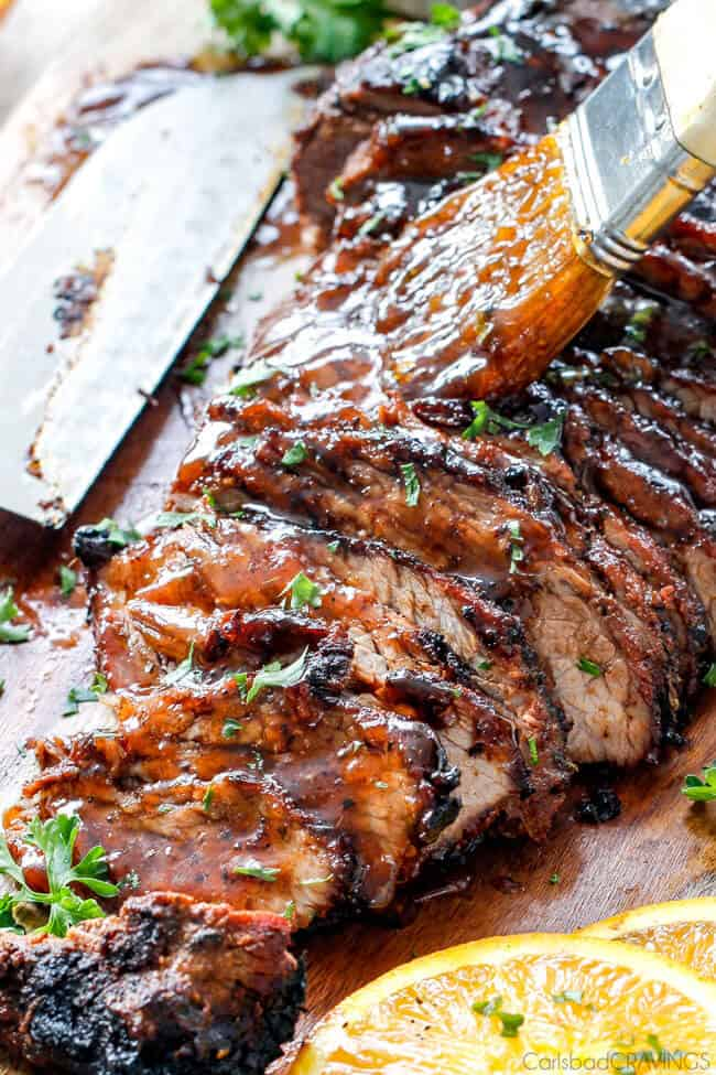 Cajun Steak with Apricot Orange Glaze being brushed on top.