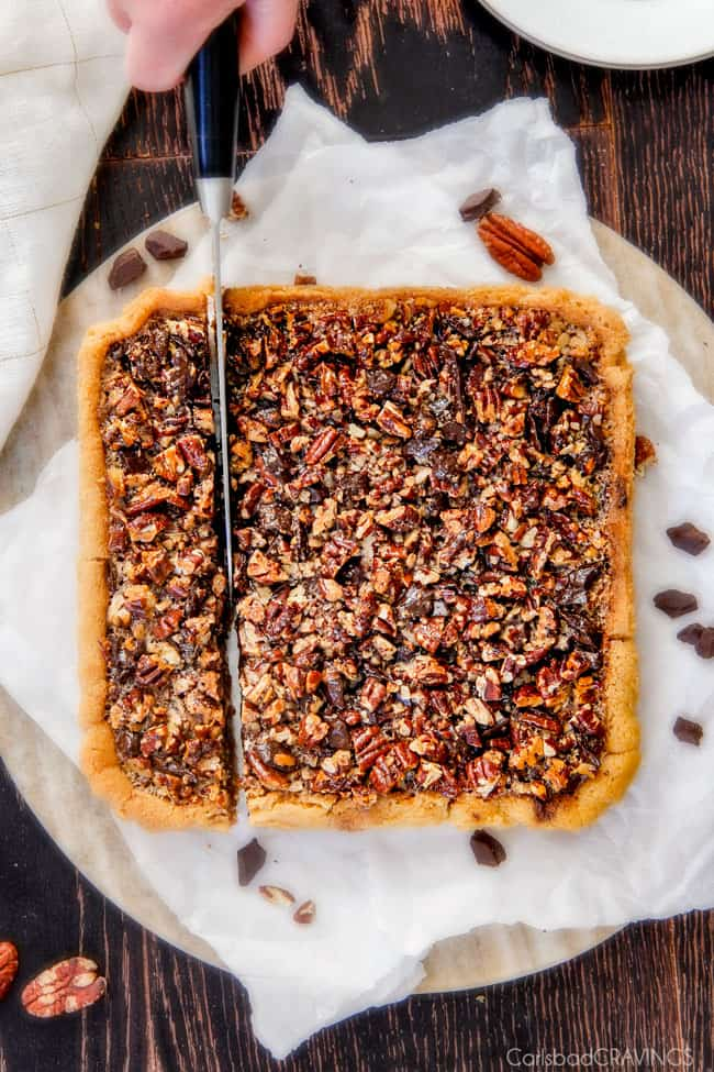 Showing how to cut a pan of Chocolate Chunk Pecan Pie Bars.