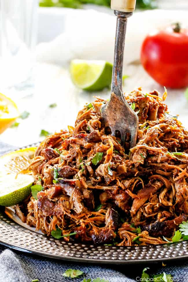 these are the BEST Pork Carnitas (Slow Cooker Mexican Pulled Pork) I have ever tried! Super juicy, easy and so much more flavorful than other versions I've tried and the crispy burnt ends are the best! Great for large crowds and for tacos, burritos, or nachos!