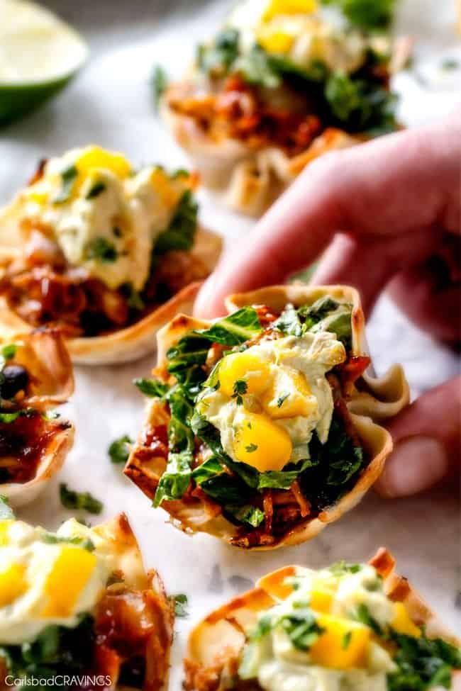 Holding a Salsa Verde Honey Lime Chicken Taco Cups.