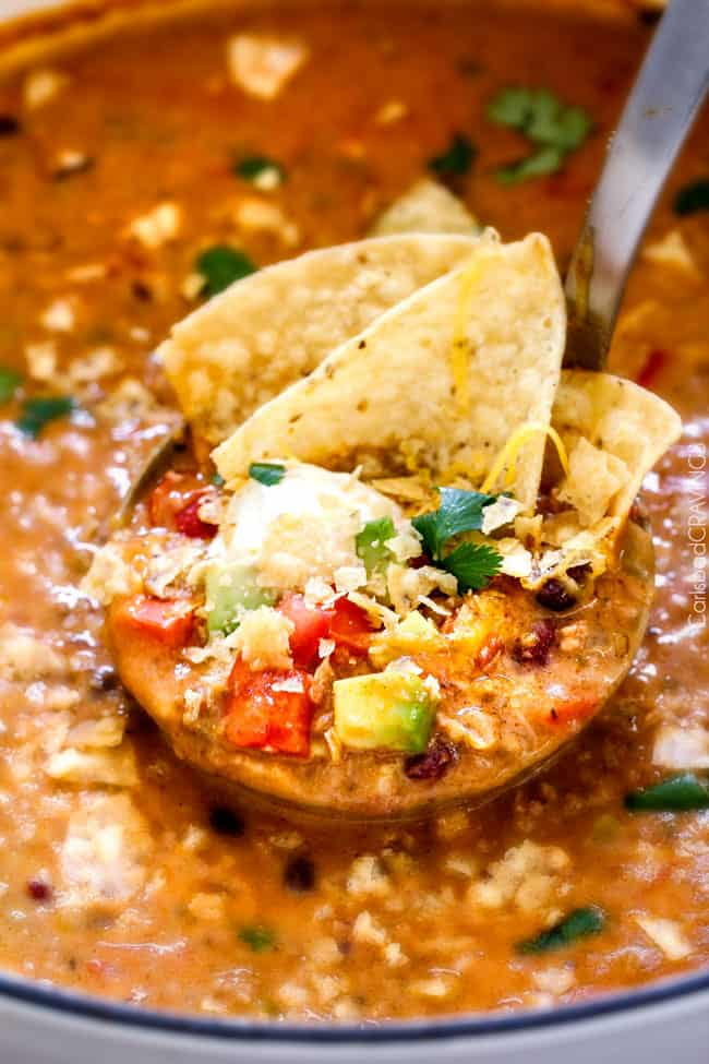 up close of a spoon full of taco soup with ground beef, tomatoes, corn, onions, black beans