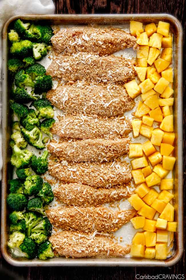 broccoli, peanut chicken and pineapple on baking sheet ready to go in oven