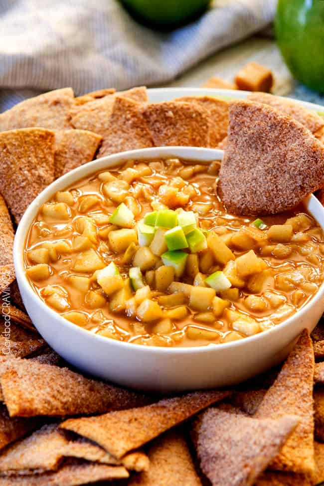 Salted Caramel Peanut Butter Apple Pie Dip - I cannot stop eating this dip!!! Warm, cinnamon brown sugar apples smothered in peanut butter caramel sauce AKA INSANE!! #thanksgiving #appetizer #Fall