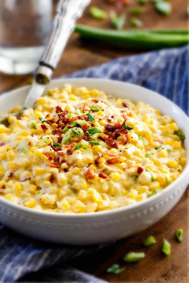 Slow Cooker Creamed Corn with Ricotta and Bacon - this has to be the BEST CREAMED CORN I've eaten in my entire life! Rich and creamy, seasoned to perfection, SO easy and practically fool proof! Definitely making this every Thanksgiving from now on!
