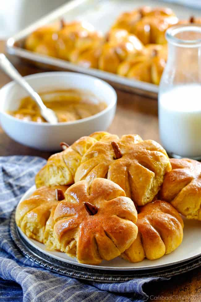 Fluffy, soft and tender Pumpkin in Dinner Rolls will be the talk of your Thanksgiving Table! Adorably delicious and easier than you might think!