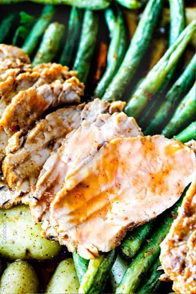 Sliced Pork Tenderloin on green beans.