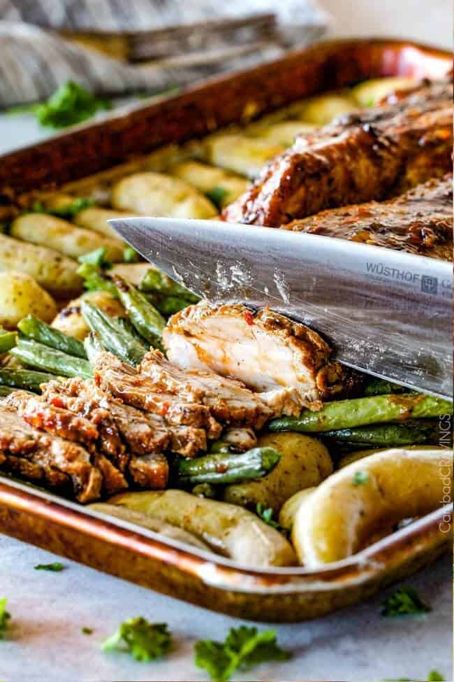 Sheet Pan Chili Dijon Pork Tenderloin with Green Beans and Potatoes all baked on ONE PAN! This is the most tender pork I have ever had and the tangy sweet and spicy flavors are out of this world!