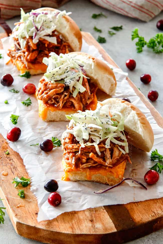 20 Minute Chipotle BBQ Cranberry Turkey Sliders (or chicken!) are a wonderfully delicious way to devour your Thanksgiving turkey leftovers or SO good you will want to make them forever and ever with chicken! And don't skip the crunchy, sweet and tangy out of this world Apple Poppy Seed Slaw!