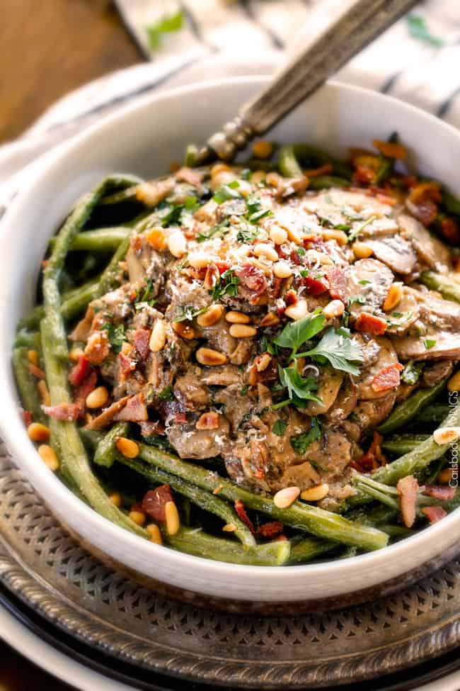up close of a big white bowl of Roasted Green Beans with Bacon