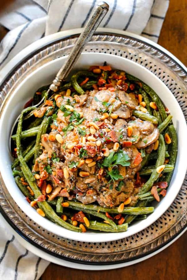 Roasted Green Beans with Cremini Bacon Mushroom Sauce - these beans are amazing! wonderfully flavorful, crisp tender and the silky Cremini Bacon Mushroom Sauce is out of this world! If you are looking for an alternative to green bean casserole, this is it! #thanksgiving