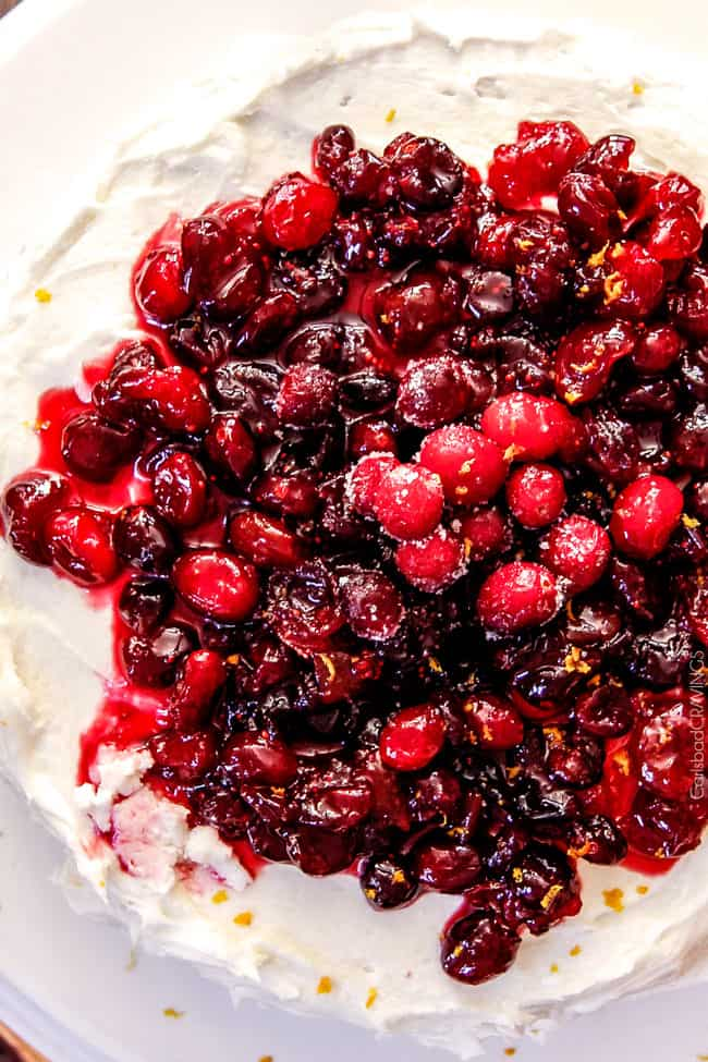 White Cake with Cranberries on top.