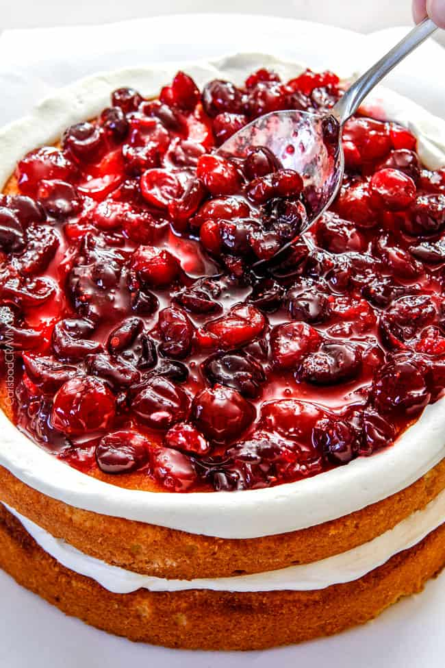Showing how to assemble a cranberry cake.
