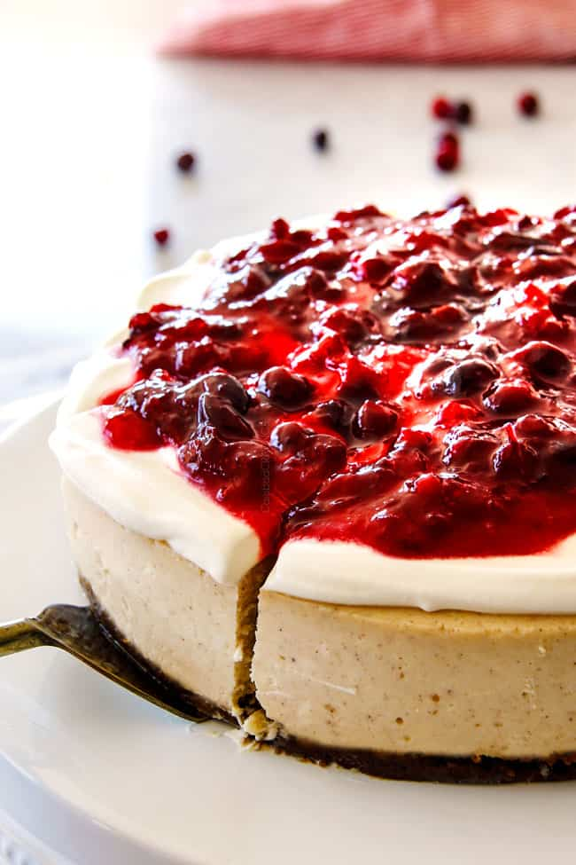 Serving a slice of Cranberry Eggnog Cheesecake