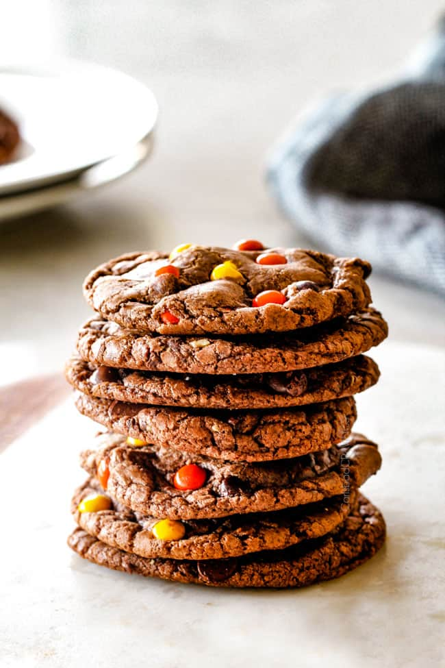 a stack of nutella cookies on a white marble cutting board
