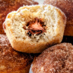 EASY Nutella Stuffed Snickerdoodle Muffins AKA muffins dunked in butter and generously coated in cinnamon-sugar for a baked muffin that tastes like a fried donut AND each stuffed with creamy Nutella! These muffins are super quick to whip up and make the best special occasion breakfasts or dessert (like Christmas!)