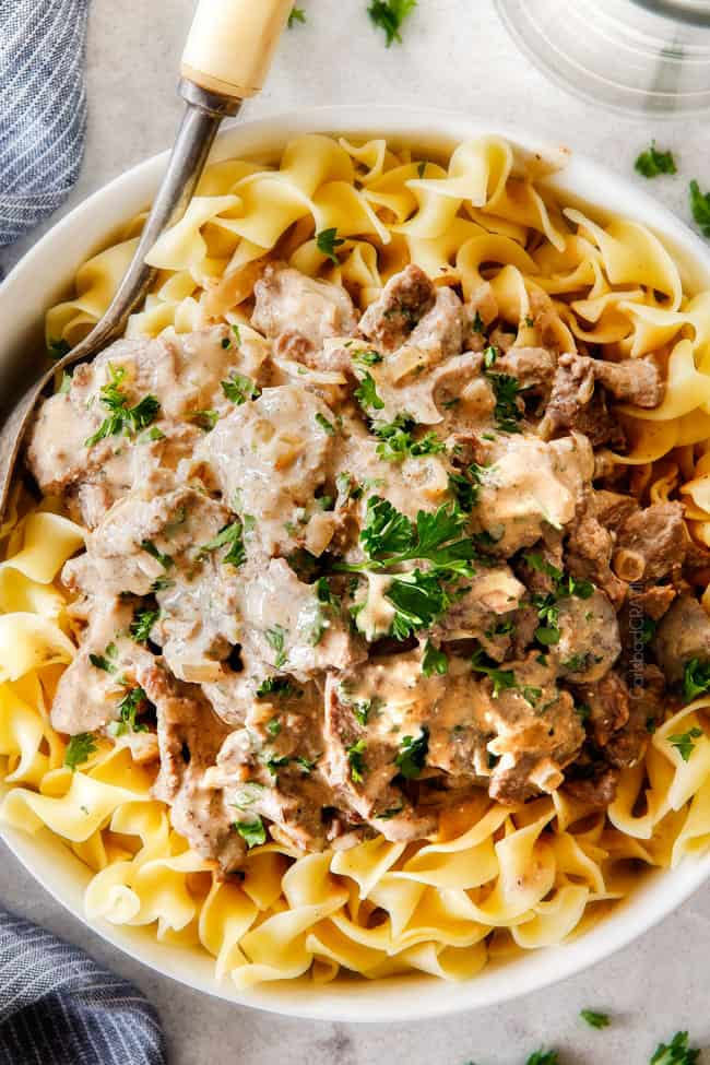 "This is by far my family's favorite Slow Cooker Beef Stroganoff recipe! An ultra rich and creamy, amazingly flavorful sauce (without any ""cream of"" anything!), crazy tender meat all made in the crockpot for a gourmet meal with hardly any effort! I love serving this for holidays like Christmas!"