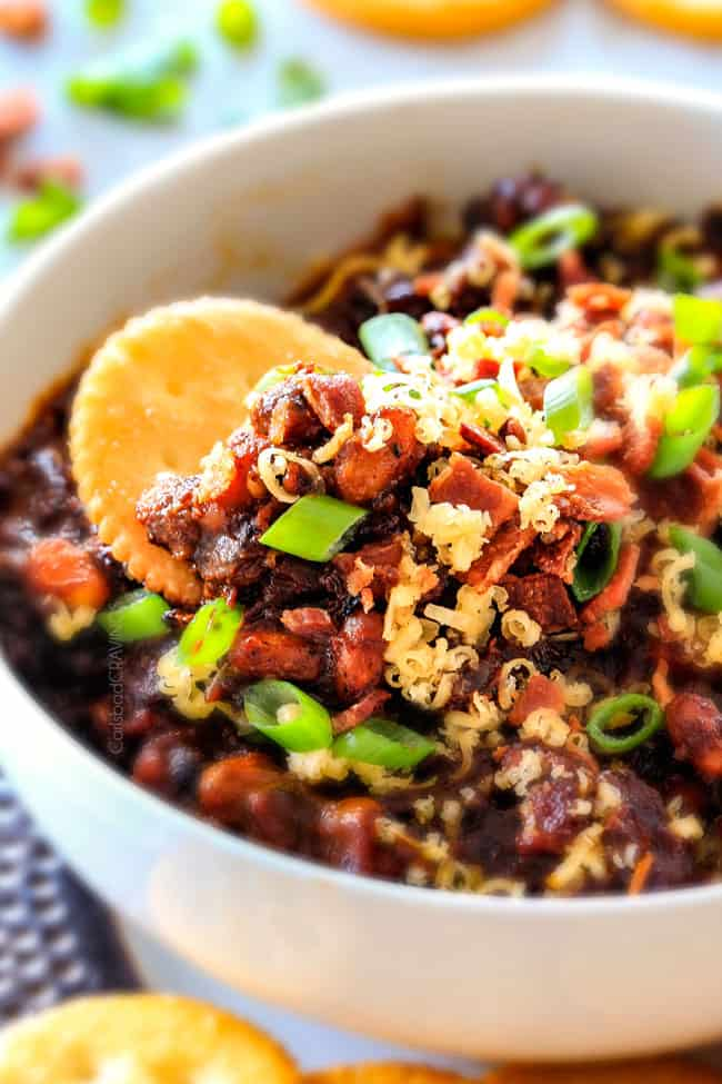 Super easy Boston Baked Bean Dip piled with bacon, cheese, sour green and green onions for your favorite sweet and tangy beans in savory scoop form! Always a crowd pleasing appetizer!